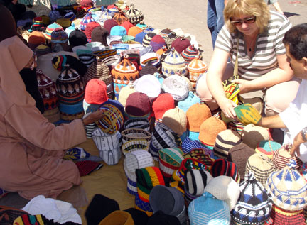 Bronwyn buying hats in Morocco